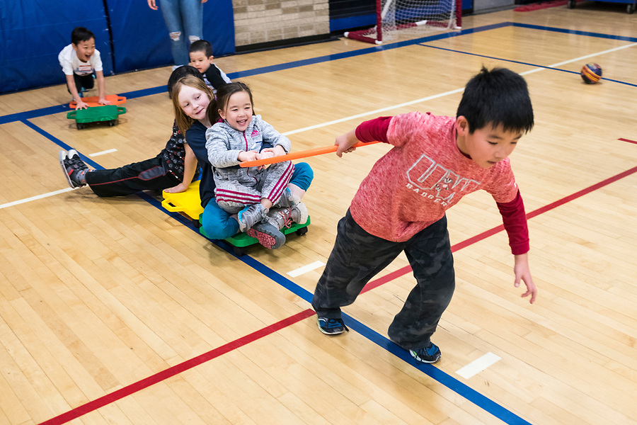 Children play during a lunar new year event hosted by Families Through Korean Adoption (FTKA) in the gym and school cafeteria of St. Dennis Church in Madison, Wis., on Feb. 10, 2018. The event celebrated the passing of the lunar new year, and is one of several events for FTKA-member families and children to gather and enjoy cultural fun, food and play. (Photo by Jeff Miller - www.jeffmillerphotography.com)
