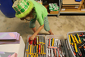 Lilly Wiedeba, 9, looks through toy trains available for sale at the Scrape Exchange on Friday, May 23rd, 2008 in Durham. Wiedeba was using items purchased at the Scrape Exchange to make a homemade birthday present for her father.