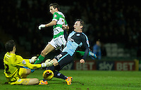 Garry Thompson of Wycombe Wanderers beats Wes Fogden of Yeovil Town but his shot is saved by Chris Weale of Yeovil Town during the Sky Bet League 2 match between Yeovil Town and Wycombe Wanderers at Huish Park, Yeovil, England on 24 November 2015. Photo by Andy Rowland.