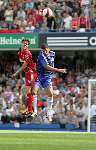 17 September 2006: Liverpool midfielder Xabi Alonso jumps for the ball with Michael Ballack during the Premiership game between Chelsea and Liverpool, played at Stamford Bridge. Chelsea won the match 1-0. Photo: Actionplus....060917 football soccer player