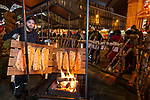 BRUSSELS - BELGIUM -11 December 2018  -- Christmas market in Brussels features a specialty: the Finnish Village. -- Heikki Hassi from Kittilä Finland is taking care of the blazed salmon with open fire, which is the most photographed stand in the village. -- PHOTO: Juha ROININEN / EUP-IMAGES