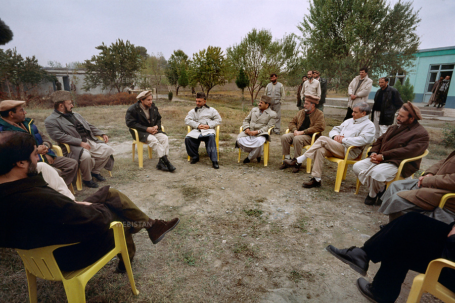 Afghanistan. Takhar Province. Dargad. 2000. Commander Massoud (1953-2001), chief of the Northern Alliance, receives delegations of Afghans, amongst whom Hamid Karzai, the current Afghan president (on the right of Massoud) come to ask for a great counsel of national unity to be held on Afghan land. <br /> <br /> Afghanistan. Province du Takhar. Dargad. 2000. Le commandant Massoud (1953-2001), chef de l'Alliance du Nord, re&ccedil;oit des d&eacute;l&eacute;gations d'Afghans vivant &agrave; l'&eacute;tranger, dont l'actuel president afghan Hamid Karzai (&agrave; droite de Massoud) venues demander la tenue d'un conseil d'unit&eacute; nationale en terre afghane.