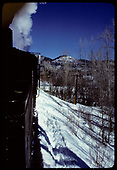 A partial rear engineer's-side view of an unidentifed eastbound locomotive approaching the Chama River bridge, as taken from the train.<br /> C&amp;TS  Chama, NM  prior to 2/1978