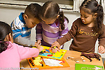 Education preschool 2-3 year olds horizontal group of children playing with puzzle