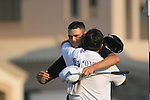 Martin Kaymer hugs his caddy after finishing his round on the 18th green during the Final Day of the Dubai World Championship, Earth Course, Jumeirah Golf Estates, Dubai, 28th November 2010..(Picture Eoin Clarke/www.golffile.ie)