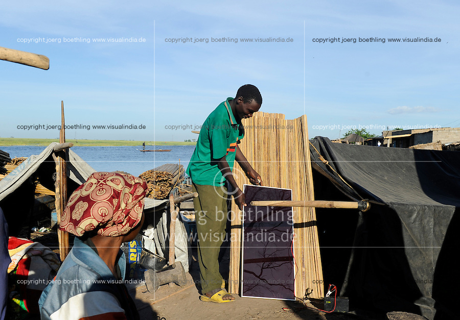 "Afrika Sambia Barotseland Mongu in der Flutebene des Sambesi Fluss, Fischer mit Solar Home System | .Africa ZAMBIA Barotseland Mongu, Zambezi floodland,  fisherman with solar home system .| [ copyright (c) Joerg Boethling / agenda , Veroeffentlichung nur gegen Honorar und Belegexemplar an / publication only with royalties and copy to:  agenda PG   Rothestr. 66   Germany D-22765 Hamburg   ph. ++49 40 391 907 14   e-mail: boethling@agenda-fototext.de   www.agenda-fototext.de   Bank: Hamburger Sparkasse  BLZ 200 505 50  Kto. 1281 120 178   IBAN: DE96 2005 0550 1281 1201 78   BIC: ""HASPDEHH"" ,  WEITERE MOTIVE ZU DIESEM THEMA SIND VORHANDEN!! MORE PICTURES ON THIS SUBJECT AVAILABLE!! ] [#0,26,121#]"