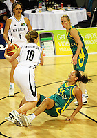 Tall Ferns forward Lisa Wallbutton knocks down Rohanee Cox during the International women's basketball match between NZ Tall Ferns and Australian Opals at Te Rauparaha Stadium, Porirua, Wellington, New Zealand on Monday 31 August 2009. Photo: Dave Lintott / lintottphoto.co.nz