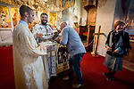 A parishioner venerates the cross at the end of liturgy service at the Church of the Ascension of Jesus Christ at the Monastery Mileševa, Serbia originally built in the 13th century. Reverend Hieromonk Leontije, monastery priest