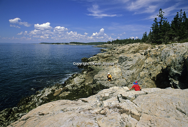 Two boys on the rocky shore of Acadia National Park, Isle Au Haut, Maine, USA