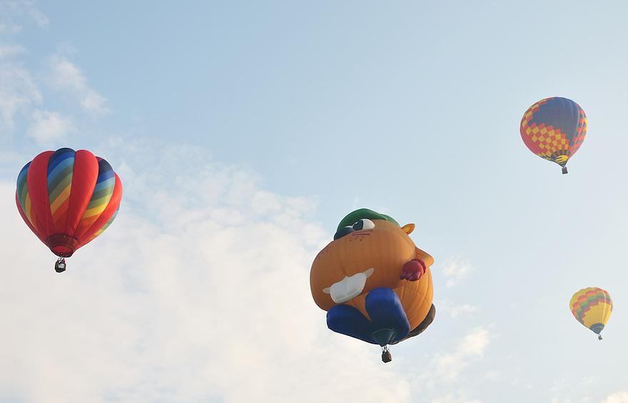 A quartet of Hot Air Balloons silently floats overhead at the Lewiston-Aubrun Balloon Festival.