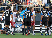 Referee Andrew Chapin gives a red card to Luke Sassano of Red Bull during the game at Buck Shaw Stadium in Santa Clara, California.  San Jose Earthquakes defeated New York Red Bulls, 4-0.