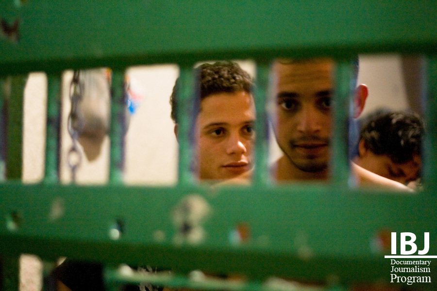 Prisoners share their stories at a cadeia, or prison, located outside of Divinopolis, Brazil. The cadeia is meant to hold only accused individuals but is twice over capacity with both accused and convicted criminals. 2008 JusticeMaker Dr. Aziz Saliba, based out of Divinopolis, is creating educational DVDs on habeas corpus and the Inter-American Court.