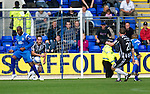 St Johnstone v St Mirren...11.09.10  .Sean Lynch scores for St Mirren after his shots deflects off Michael Duberry to wrong foot keeper Peter Enckleman.Picture by Graeme Hart..Copyright Perthshire Picture Agency.Tel: 01738 623350  Mobile: 07990 594431