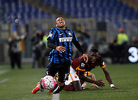 Calcio, Serie A: Roma vs Inter. Roma, stadio Olimpico, 19 marzo 2016.<br /> FC Inter&rsquo;s Jonathan Biabiany, left, is fouled by Roma&rsquo;s Antonio Ruediger during the Italian Serie A football match between Roma and FC Inter at Rome's Olympic stadium, 19 March 2016. The game ended 1-1.<br /> UPDATE IMAGES PRESS/Isabella Bonotto