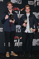 LOS ANGELES, CA, USA - APRIL 13: Sam Claflin, Josh Hutcherson in the press room at the 2014 MTV Movie Awards held at Nokia Theatre L.A. Live on April 13, 2014 in Los Angeles, California, United States. (Photo by Xavier Collin/Celebrity Monitor)