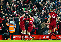 Liverpool's Mohamed Salah celebrates scoring his side's fourth goal with Andrew Robertson<br /> <br /> Photographer Alex Dodd/CameraSport<br /> <br /> The Premier League - Liverpool v Manchester City - Sunday 14th January 2018 - Anfield - Liverpool<br /> <br /> World Copyright &copy; 2018 CameraSport. All rights reserved. 43 Linden Ave. Countesthorpe. Leicester. England. LE8 5PG - Tel: +44 (0) 116 277 4147 - admin@camerasport.com - www.camerasport.com