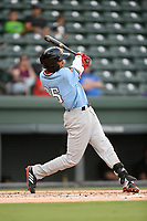 Center fielder Bubba Thompson (25) of the Hickory Crawdads follows through on a swing during a game against the Greenville Drive on Monday, July 23, 2018, at Fluor Field at the West End in Greenville, South Carolina. Hickory won, 6-1. (Tom Priddy/Four Seam Images)