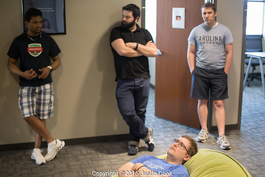 Software Engineer Cole Faloon (CQ) during a meeting at the Automated Insights office in Durham, N.C. on Thursday, May 7, 2015. An Automated Insights algorithm was pitted against an NPR reporter to see who could write the best news brief about a Denny's earnings report. (Justin Cook)