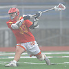 Will Kusnierek #33 of Chaminade recoils to snap off a shot during a non-league varsity boys lacrosse game against host Massapequa High School on on Wednesday, April 4, 2018. Chaminade won by a score of 8-5.