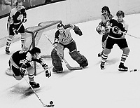 Boston Bruins Derek Sanderson reaching for the puck, with Bobby Orr against Seals Gilles Meloche and <br />caron Vadnais. (1973 photo/Ron Riesterer)