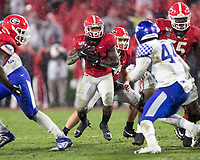 ATHENS, GA - OCTOBER 19: D'Andre Swift #7 of the Georgia Bulldogs looks for a gap to run through during a game between University of Kentucky Wildcats and University of Georgia Bulldogs at Sanford Stadium on October 19, 2019 in Athens, Georgia.
