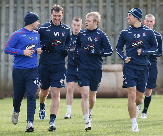Steven Naismith chats with coach Adam Owen along with Andy Webster and Steven Whittaker