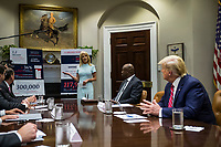 White House Counselor Kellyanne Conway speaks during an opioid round table at the White House in Washington, DC, USA, 12 June 2019.  Also pictured is U.S. President Donald Trump.<br /> Credit: Zach Gibson / Pool via CNP/AdMedia