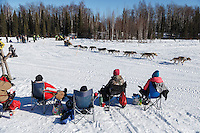 Rick Casillo runs on Long Lake past spectarors having a picnic during the Restart of the 2016 Iditarod in Willow, Alaska.  March 06, 2016.