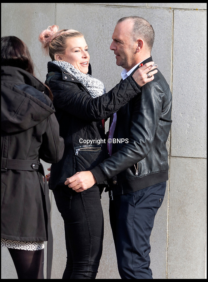 BNPS.co.uk (01202 558833)<br /> Pic:  RogerArbon/BNPS<br /> <br /> This is the moment a businessman hugs the girlfriend he almost killed by pushing her over a 20ft wall after her forgiveness helped spare him from prison.<br /> <br /> Andrew Pilliner grabbed Clara Martin around the throat, picked up her legs and launched her over the parapet during a drunken argument on a night out.<br /> <br /> Miss Martin landed head first on concrete and suffered a broken neck and a head injury but luckily survived.<br /> <br /> Despite the seriousness of the attack, Miss Martin told police officers from her hospital bed that she still loved her partner of 10 years and did not want him to face charges.
