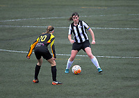 Action from the 2018 Women's Capital Premier football match between Waterside Karori (white and black stripes) and Island Bay United AFC Flames (yellow and black) at Wakefield Park in Wellington, New Zealand on Sunday, 1 July 2018. Photo: Dave Lintott / lintottphoto.co.nz