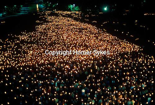 Lourdes night candel lit procession France.