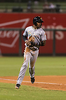 AFL East center fielder Monte Harrison (4), of the Salt River Rafters and the Miami Marlins organization, rounds third base during the Arizona Fall League Fall Stars game at Surprise Stadium on November 3, 2018 in Surprise, Arizona. The AFL West defeated the AFL East 7-6 . (Zachary Lucy/Four Seam Images)