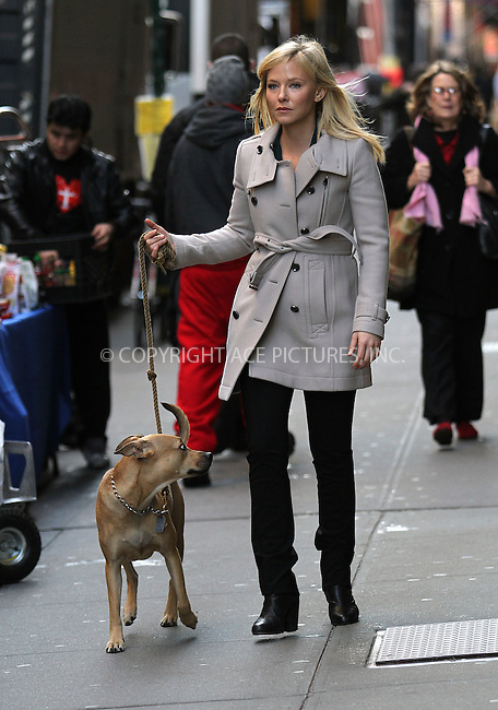 WWW.ACEPIXS.COM......December 13 2012, New York City....Actress Kelli Giddish walks her dog Frannie on the set of 'Law and Order, SVU' on December 13 2012 in New York City......By Line: Zelig Shaul/ACE Pictures......ACE Pictures, Inc...tel: 646 769 0430..Email: info@acepixs.com..www.acepixs.com
