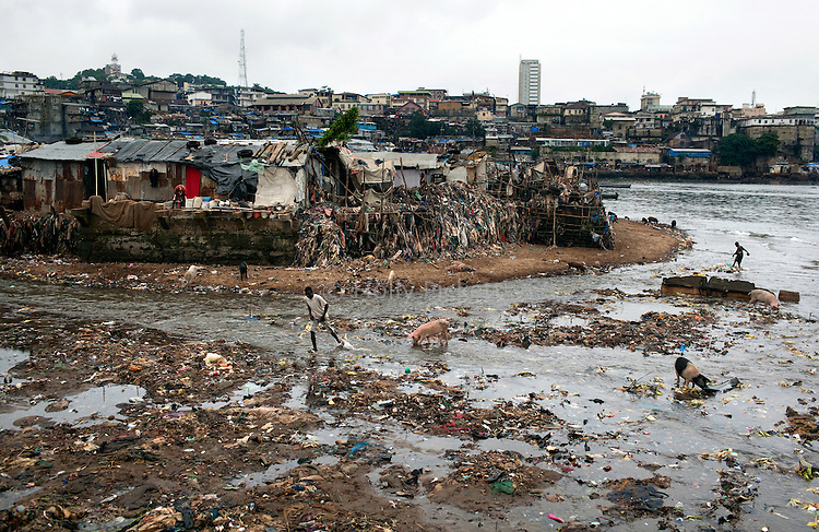 The shore next to Mabella is littered with trash, and untreated sewage flows into the ocean, in Mabella quarter, Freetown, Sierra Leone, Aug. 13, 2012. Médecins Sans Frontières Belgium, in collaboration with the Sierra Leone Ministry of Health, is running four emergency cholera treatment centers to keep up with the number of patients. Many of the roughly 120 daily patients seen by the MSF team come from extremely impoverished areas of the densely-populated capital, where proper systems for drainage and waste disposal are almost non-existent. Outbreaks of water-borne diseases like cholera become even more likely during the rainy season, which is expected to last at least two more months.