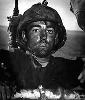 Back to a Coast Guard assault transport comes this Marine after two days and nights of Hell on the beach of Eniwetok in the Marshall Islands.  His face is grimey with coral dust but the light of battle stays in his eyes.  February 1944. (Coast Guard)<br /> Exact Date Shot Unknown<br /> NARA FILE #:  026-G-3394<br /> WAR &amp; CONFLICT BOOK #:  1198