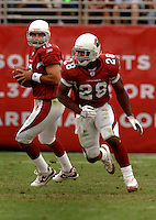 Nov. 6, 2005; Tempe, AZ, USA; Quarterback (13) Kurt Warner looks to pass to running back (28) J.J. Arrington of the Arizona Cardinals against the Seattle Seahawks at Sun Devil Stadium. Mandatory Credit: Mark J. Rebilas