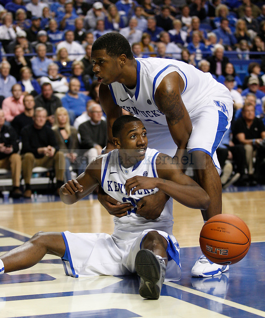 Terrence Jones helps up teammate Marquis Teague in the second half of the game against St. Johns University at Rupp Arena, in Lexington, Ky., on Thursday, Dec. 1, 2011. Kentucky won 81-59. Photo by Latara Appleby | Staff ..