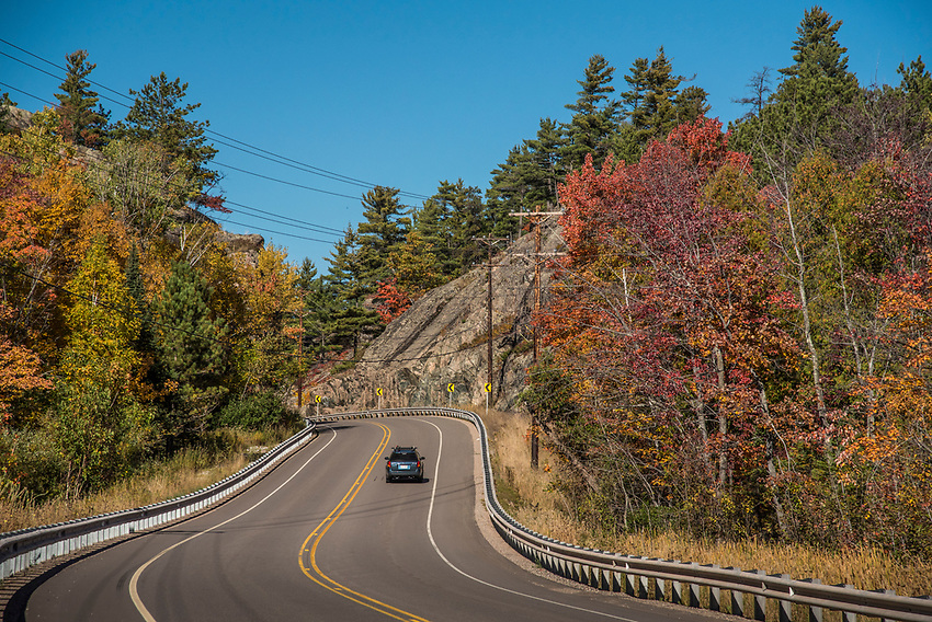 Fall color drive through the rock cut near Sugarloaf Mountain on County Road 550 near Marquette, Michigan.