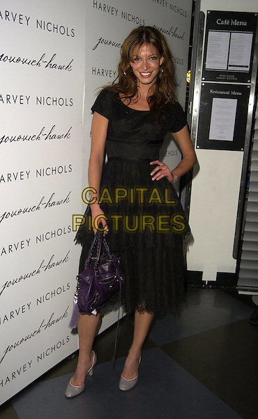 LAUREN GOLD.The Jovovich-Hawk clothing range UK launch, Harvey Nicholls, London, UK..April 27th, 2006.Ref: CAN.full length black sheer dress hand on hip.www.capitalpictures.com.sales@capitalpictures.com.©Capital Pictures