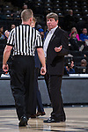 North Carolina State Wolfpack head coach Wes Moore discusses a call with referee Mark Resch during a first half timeout in the game against the Wake Forest Demon Deacons at the LJVM Coliseum on January 8, 2017 in Winston-Salem, North Carolina.  The Wolfpack defeated the Demon Deacons 65-50.  (Brian Westerholt/Sports On Film)