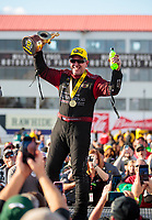 Feb 23, 2020; Chandler, Arizona, USA; NHRA funny car driver Tommy Johnson Jr celebrates after winning the Arizona Nationals at Wild Horse Pass Motorsports Park. Mandatory Credit: Mark J. Rebilas-USA TODAY Sports
