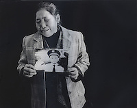 "Mrs Xiang, 40, holds a picture of her son Ren Pan, who was 4 and half years old when he was stolen 9th September 2003. The message reads ""Hope my son can come back home safe.""..PHOTO BY SINOPIX"