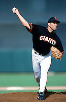 Robb Nen of the San Francisco Giants pitches during a 1999 Major League Baseball Spring Training Game in Phoenix, Arizona. (Larry Goren/Four Seam Images)