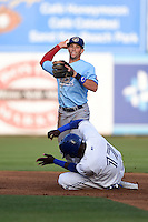 Daytona Cubs second baseman Tim Saunders (8) attempts to turn a double play as Gustavo Pierre (17) slides in during a game against the Dunedin Blue Jays on April 14, 2014 at Florida Auto Exchange Stadium in Dunedin, Florida.  Dunedin defeated Daytona 1-0  (Mike Janes/Four Seam Images)
