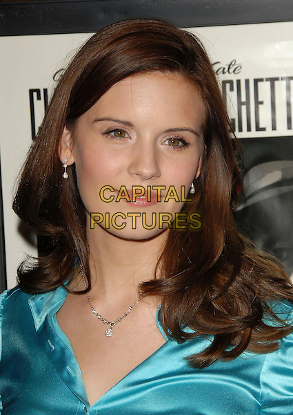 MAGGIE GRACE.attends The Warner Brothers Pictures Los Angeles Premiere of The Good German held at The Egyptian Theatre in Hollywood, California, USA, December 4th 2006..portrait headshot brunette hair turquoise satin blouse.CAP/DVS.©Debbie VanStory/Capital Pictures