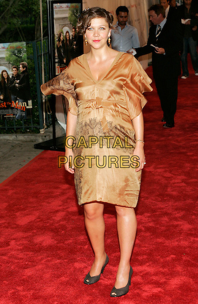 "MAGGIE GYLLENHAAL.At the NY Premiere of ""Trust the Man"" at Chelsea West Theatre - Outside Arrivals, New York, NY, USA..August 7th, 2006.Photo: Jackson Lee/AdMedia/Capital Pictures.Ref: ADM/JL.full length gold sleevless satin yellow dress pregnant.www.capitalpictures.com.sales@capitalpictures.com.©Jackson Lee/AdMedia/Capital Pictures."