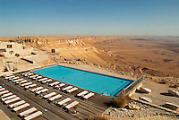 "Set on the edge of the spectacular Ramon Crater in the Negev Desert, the Beresheet Hotel opened in Mitzpe Ramon in 2011. The latest addition to the Isrotel chain it has 111 ""small houses"" or suites built with local materials to blend into the desert environment."
