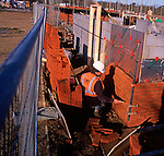 A5EXHF Bricklayers building a new wall on a building site