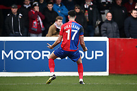 Conor Wilkinson of Dagenham and Redbridge scores the second goal for his team and celebrates in front of the away fans during Dagenham & Redbridge vs Bromley, Vanarama National League Football at the Chigwell Construction Stadium on 9th March 2019