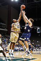 February 03, 2011:    Jacksonville Dolphins forward Ayron Hardy (10) goes up to block the jump shot of Belmont Bruins guard/forward J.J. Mann (14) during Atlantic Sun Conference action between the Jacksonville Dolphins and the Belmont Bruins at Veterans Memorial Arena in Jacksonville, Florida.  Belmont defeated Jacksonville 76-70.